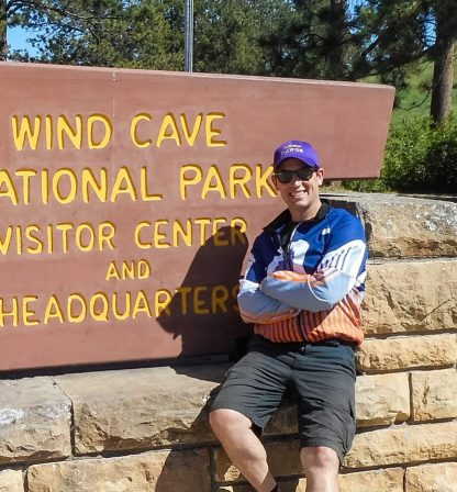 man in front of wind cave
