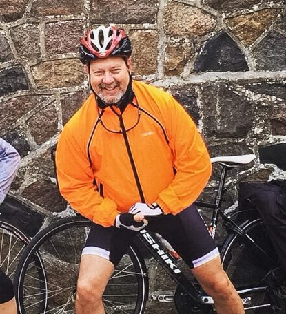 man in front of mountain bike