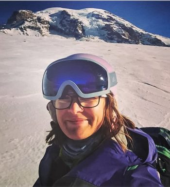 woman at snowy mountain base