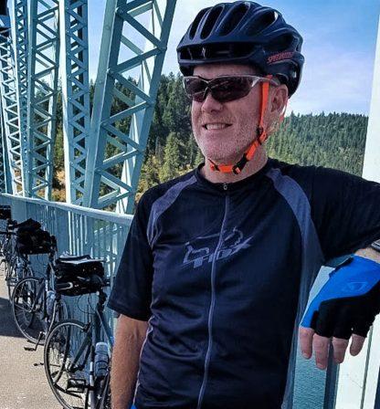 man on bridge with mountain bike