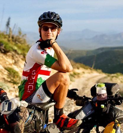 man posing with mountain bike