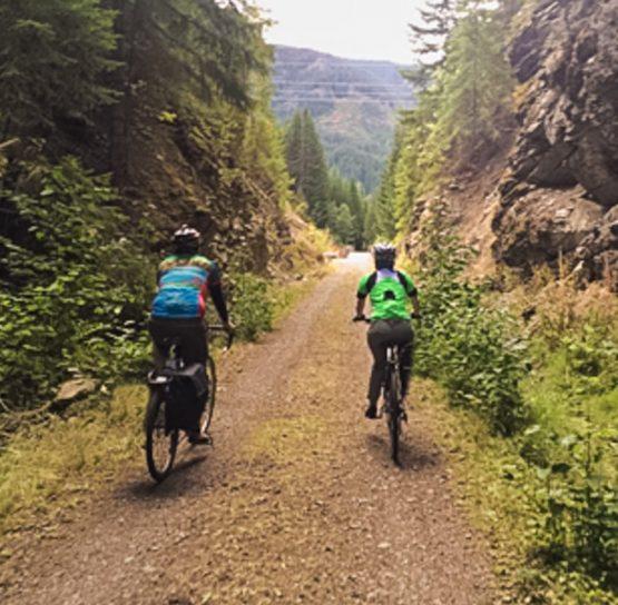 Two bikers on Mountains to Sound Bike Tour
