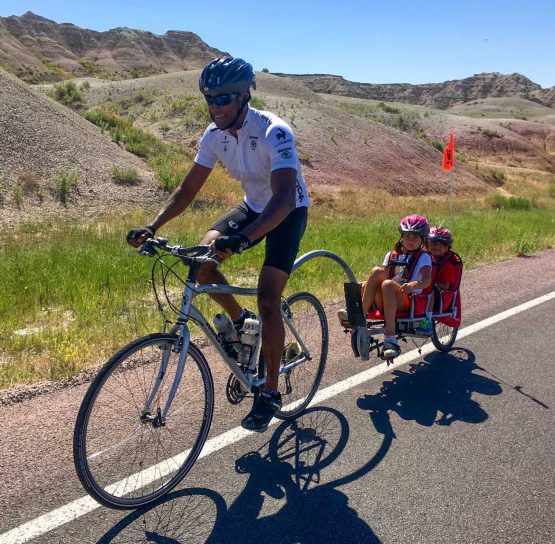Man biking with kids on Mt. Rushmore Family Tour