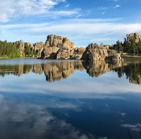 Reflection on lake on Mt. Rushmore Family Tour