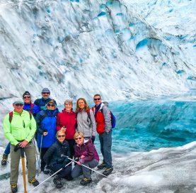 Group at glacier on New Zealand Bike Tour