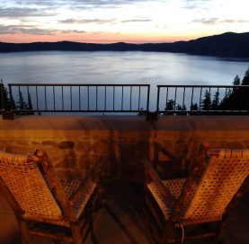 Chairs by lake on Oregon Coast to Crater Lake Bike Tour