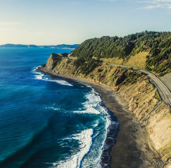 Aerial of coast on Oregon Coast to Crater Lake Bike Tour