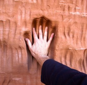 Handprint in cave in the Southern Utah National Parks tour