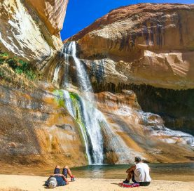 Sitting by waterfall on the Southern Utah National Parks tour