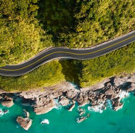 Aerial of winding road by coast on Taiwan Bike Tour