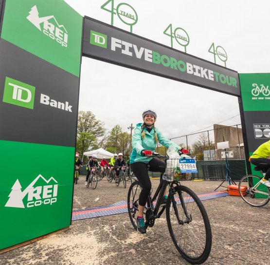 Biker under finish line at TD Five Boro Bike Tour