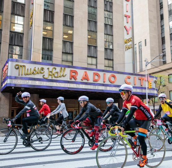 Bikers passing by Music Hall Radio City on TD Five Boro Bike Tour