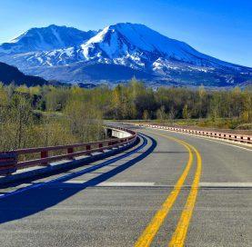 Road to mountains on the Volcanoes of Washington Tour