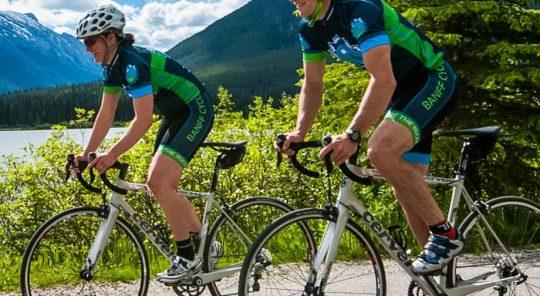 Two bicyclist on the Glacier Banff Jasper tour
