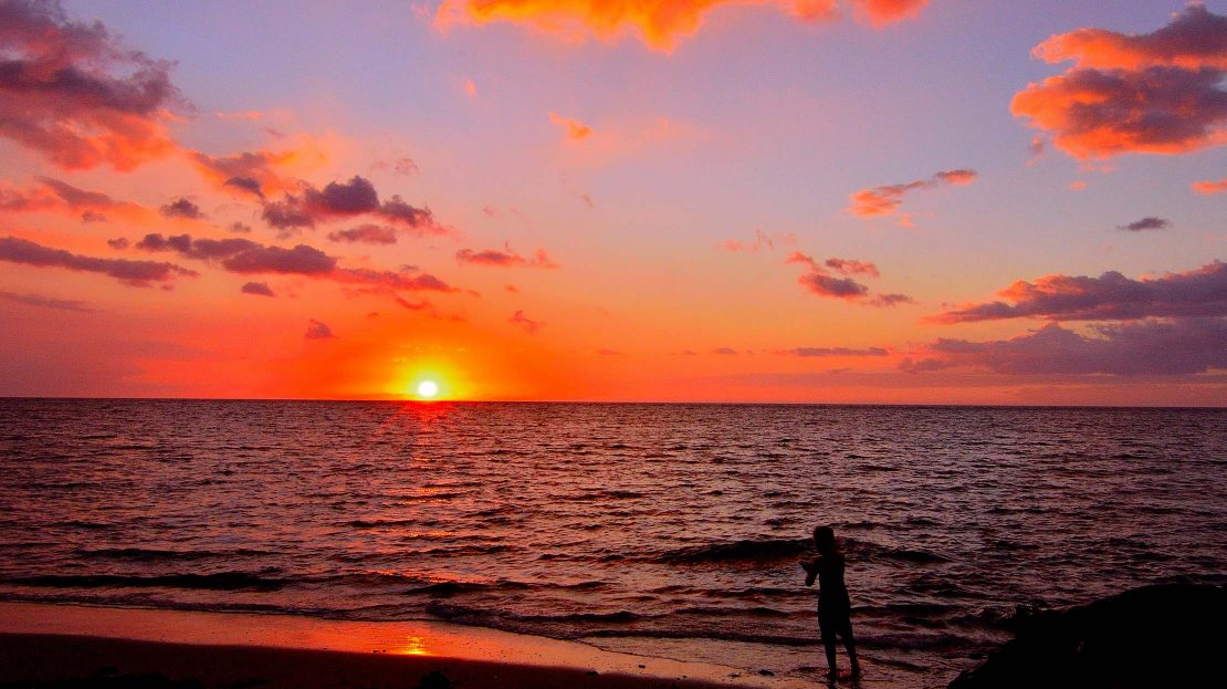 Person admiring sunset in Hawaii