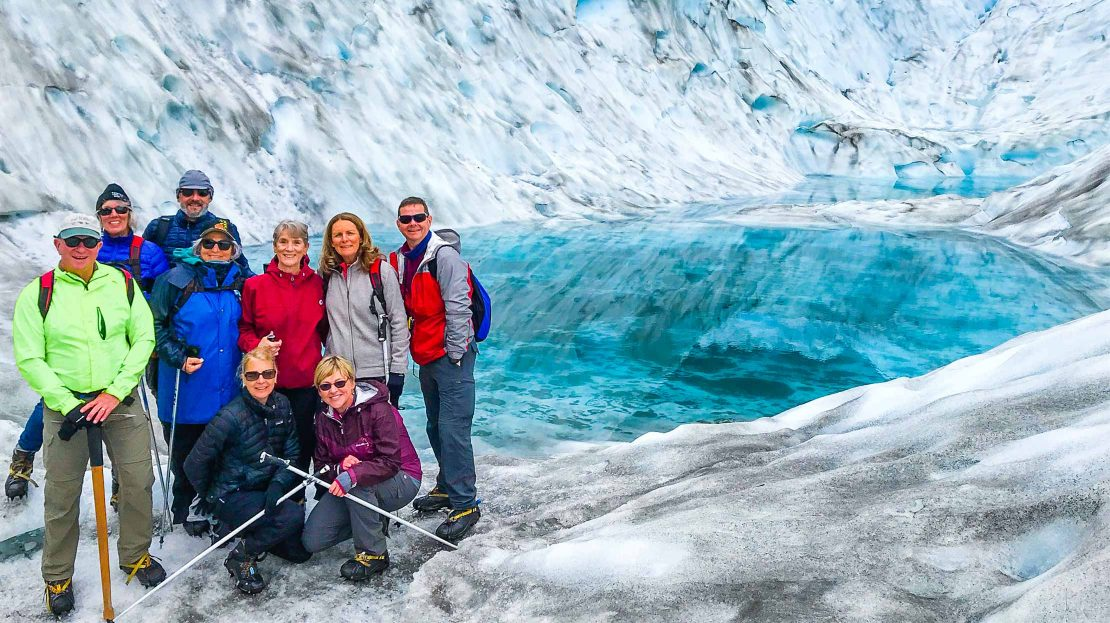 Hikers by a glacier in New Zealand