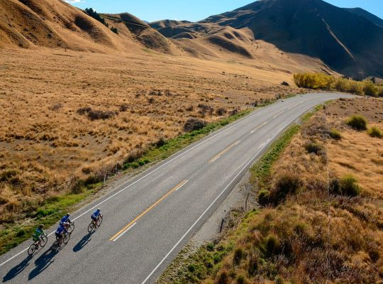 Bikers in New Zealand with mountains in background