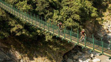 Biking across a bridge in Taiwan