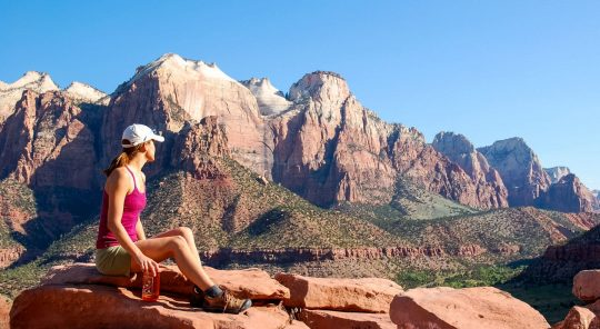 Hiker admiring the view of Zion