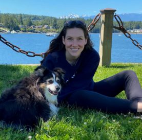 A girl and her dog with the Puget Sound and mountains in the background